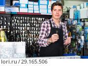 Купить «Portrait of male employee which is selling and manufacturing keys», фото № 29165506, снято 4 мая 2017 г. (c) Яков Филимонов / Фотобанк Лори