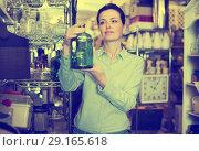 Купить «female holding glass jar», фото № 29165618, снято 22 ноября 2017 г. (c) Яков Филимонов / Фотобанк Лори