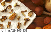 Купить «dried mushrooms on baking paper», видеоролик № 29165838, снято 30 сентября 2018 г. (c) Syda Productions / Фотобанк Лори
