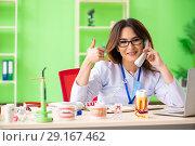 Купить «Woman dentist working on teeth implant», фото № 29167462, снято 11 июня 2018 г. (c) Elnur / Фотобанк Лори
