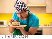Купить «Man cook preparing cake in kitchen at home», фото № 29167586, снято 13 июня 2018 г. (c) Elnur / Фотобанк Лори