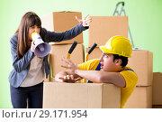 Купить «Woman boss and man contractor working with boxes delivery», фото № 29171954, снято 4 июня 2018 г. (c) Elnur / Фотобанк Лори