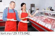 Купить «Man and woman seller offering products in shop», фото № 29173042, снято 22 июня 2018 г. (c) Яков Филимонов / Фотобанк Лори