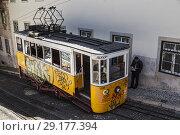 Купить «A grafitti covered, yellow Bica Funicular electric train at the upper terminus of the Elavador da Bica, on Calcada da Gloria Street, Sao Paulo, Lisbon, Lisboa, Portugal.», фото № 29177394, снято 17 февраля 2020 г. (c) age Fotostock / Фотобанк Лори