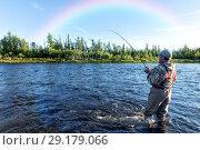 Купить «Fly fishing on a mountain river. Rainbow over the river.», фото № 29179066, снято 15 июля 2017 г. (c) Евгений Ткачёв / Фотобанк Лори