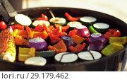 Купить «vegetables cooking on barbecue grill», видеоролик № 29179462, снято 26 сентября 2018 г. (c) Syda Productions / Фотобанк Лори