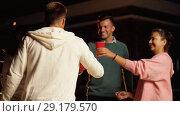 Купить «friends with drinks dancing at rooftop party», видеоролик № 29179570, снято 26 сентября 2018 г. (c) Syda Productions / Фотобанк Лори