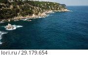 Купить «View from drone of Castell d'en Plaja in Mediterranean coastal town of Lloret de Mar, Catalonia, Spain», видеоролик № 29179654, снято 23 июня 2018 г. (c) Яков Филимонов / Фотобанк Лори