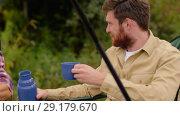 Купить «friends fishing and drinking tea from thermos», видеоролик № 29179670, снято 28 сентября 2018 г. (c) Syda Productions / Фотобанк Лори
