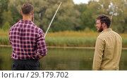Купить «happy friends with fishing rods on lake», видеоролик № 29179702, снято 28 сентября 2018 г. (c) Syda Productions / Фотобанк Лори