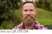 Купить «portrait of happy smiling man with beard», видеоролик № 29179734, снято 4 октября 2018 г. (c) Syda Productions / Фотобанк Лори