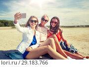 Купить «group of smiling women taking selfie on beach», фото № 29183766, снято 7 июня 2016 г. (c) Syda Productions / Фотобанк Лори