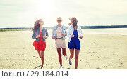 Купить «group of smiling women in sunglasses on beach», фото № 29184014, снято 7 июня 2016 г. (c) Syda Productions / Фотобанк Лори