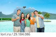 Купить «friends taking selfie by smartphone over bora bora», фото № 29184086, снято 30 июня 2018 г. (c) Syda Productions / Фотобанк Лори