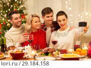 Купить «friends taking selfie at christmas dinner», фото № 29184158, снято 17 декабря 2017 г. (c) Syda Productions / Фотобанк Лори