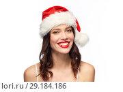 Купить «woman with red lipstick in santa hat at christmas», фото № 29184186, снято 5 января 2018 г. (c) Syda Productions / Фотобанк Лори