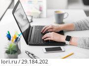 Купить «web designer with laptop working on user interface», фото № 29184202, снято 17 января 2018 г. (c) Syda Productions / Фотобанк Лори