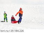 Купить «happy kids with sled having fun outdoors in winter», фото № 29184226, снято 10 февраля 2018 г. (c) Syda Productions / Фотобанк Лори
