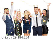 Купить «friends at christmas party throwing serpentine», фото № 29184234, снято 3 марта 2018 г. (c) Syda Productions / Фотобанк Лори