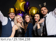 friends at christmas or new year party. Стоковое фото, фотограф Syda Productions / Фотобанк Лори