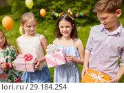 Купить «happy kids with gifts on birthday party in summer», фото № 29184254, снято 27 мая 2018 г. (c) Syda Productions / Фотобанк Лори