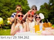 Купить «happy kids with party props on birthday in summer», фото № 29184262, снято 27 мая 2018 г. (c) Syda Productions / Фотобанк Лори