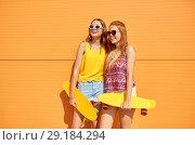 Купить «teenage girls with short skateboards outdoors», фото № 29184294, снято 19 июля 2018 г. (c) Syda Productions / Фотобанк Лори