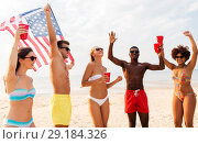 Купить «friends at american independence day beach party», фото № 29184326, снято 29 июля 2018 г. (c) Syda Productions / Фотобанк Лори