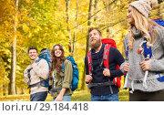 Купить «hiking friends or travelers with backpacks», фото № 29184418, снято 31 августа 2014 г. (c) Syda Productions / Фотобанк Лори