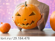 Купить «close up of woman with halloween pumpkin», фото № 29184478, снято 15 сентября 2017 г. (c) Syda Productions / Фотобанк Лори