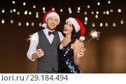 Купить «happy couple in santa hats at christmas party», фото № 29184494, снято 15 декабря 2017 г. (c) Syda Productions / Фотобанк Лори