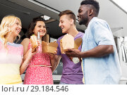 Купить «happy friends with drinks eating at food truck», фото № 29184546, снято 1 августа 2017 г. (c) Syda Productions / Фотобанк Лори