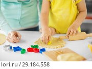Купить «mother and daughter making cookies at home», фото № 29184558, снято 20 октября 2017 г. (c) Syda Productions / Фотобанк Лори