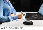 Купить «businesswoman with papers working at night office», фото № 29184594, снято 3 января 2018 г. (c) Syda Productions / Фотобанк Лори