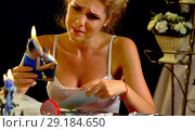 Купить «Wedding bride sitting table. Quarrel during honeymoon. Wedding memories.», фото № 29184650, снято 16 октября 2018 г. (c) Gennadiy Poznyakov / Фотобанк Лори