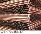 Купить «Copper or bronze metal pipes in warehouse. Heavy non-ferrous metallurgical industry.», фото № 29184662, снято 21 января 2019 г. (c) Maksym Yemelyanov / Фотобанк Лори