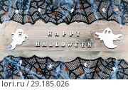 Купить «Halloween festive background. Happy Halloween letters and Halloween decorations on the wooden background», фото № 29185026, снято 6 октября 2018 г. (c) Зезелина Марина / Фотобанк Лори