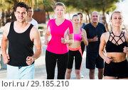 Купить «Active people during running training», фото № 29185210, снято 14 июня 2017 г. (c) Яков Филимонов / Фотобанк Лори