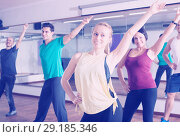 Купить «Beginner dancers learning zumba elements in dancing hall», фото № 29185346, снято 19 ноября 2019 г. (c) Яков Филимонов / Фотобанк Лори