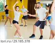 Купить «People dancing lindy hop in pairs», фото № 29185378, снято 21 июня 2017 г. (c) Яков Филимонов / Фотобанк Лори