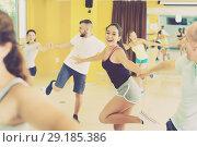 Купить «Young men and women dancing swing», фото № 29185386, снято 21 июня 2017 г. (c) Яков Филимонов / Фотобанк Лори