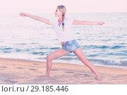 Купить «Portrait of sportswoman which is doing excercises on endurance», фото № 29185446, снято 17 июля 2017 г. (c) Яков Филимонов / Фотобанк Лори
