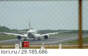 Купить «Airplane landing at Phuket airport», видеоролик № 29185686, снято 22 июня 2018 г. (c) Игорь Жоров / Фотобанк Лори