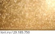 Купить «Golden glitter background», видеоролик № 29185750, снято 2 сентября 2018 г. (c) Иван Михайлов / Фотобанк Лори