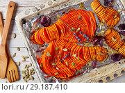 Купить «sliced pumpkin baked in an oven», фото № 29187410, снято 6 октября 2018 г. (c) Oksana Zh / Фотобанк Лори