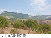 Купить «Views of the famous mountain Demerdzhi with the track. Demerdzhi is a landmark of Crimea», фото № 29187454, снято 9 августа 2012 г. (c) Олег Хархан / Фотобанк Лори