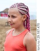 Купить «Portrait of beautiful girl with pink dreadlocks standing outdoor», фото № 29187470, снято 19 июля 2018 г. (c) Кекяляйнен Андрей / Фотобанк Лори