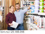 Купить «Two designer with shop list looking paint», фото № 29188098, снято 16 февраля 2018 г. (c) Яков Филимонов / Фотобанк Лори