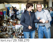 Купить «thoughtful mature spouses buying retro handicrafts on flea market», фото № 29188270, снято 23 октября 2017 г. (c) Яков Филимонов / Фотобанк Лори