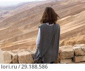 Купить «Rear view of woman in desert, Scorpions Ascent, Arava Valley, Negev Desert, Israel», фото № 29188586, снято 22 августа 2019 г. (c) Ingram Publishing / Фотобанк Лори